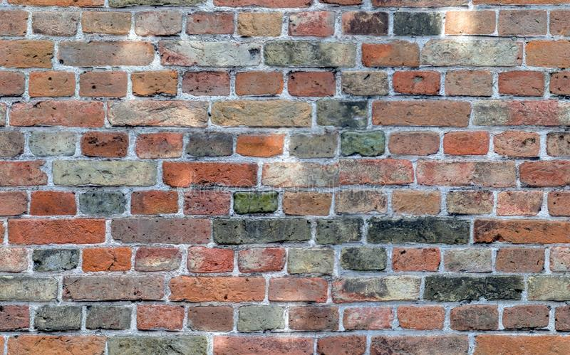 无缝的样式,纹理,砖墙,用不同的色的砖的纹理,红色,绿色,灰色,棕色与光反射 免版税库存照片