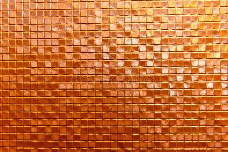 无缝的橙色墙壁陶瓷砖背景 库存图片