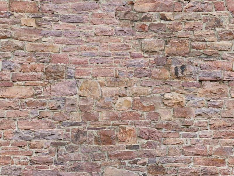 无缝的石英岩石墙背景瓦片 免版税库存照片