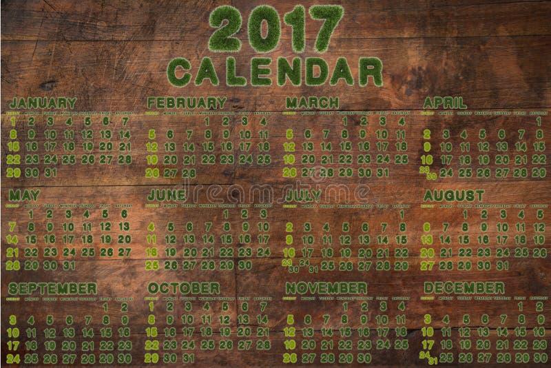 日历在2017年在木背景 向量例证