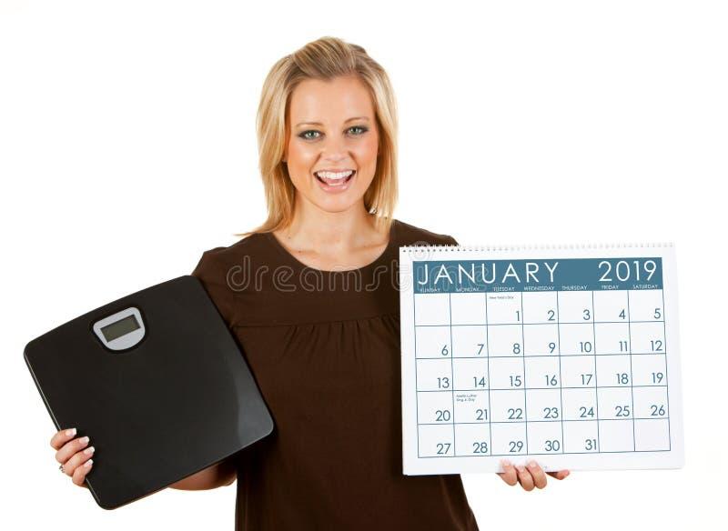 2019日历:妇女激发在1月节食 免版税库存图片