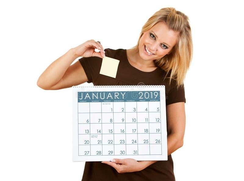 2019日历:把稠粘的笔记放在日期上 免版税库存图片