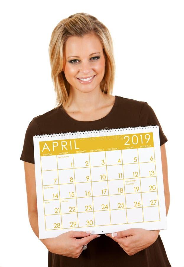 2019日历:拿着空白4月日历 库存图片