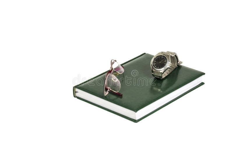 日志、时钟和镜片在白色背景说谎 免版税库存照片