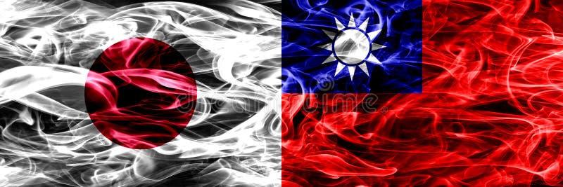 日本对台湾,肩并肩被安置的台湾烟旗子 库存照片