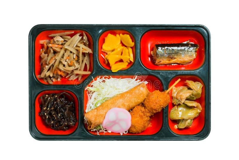 日本烤鱼和其他的食物套在箱子 库存图片