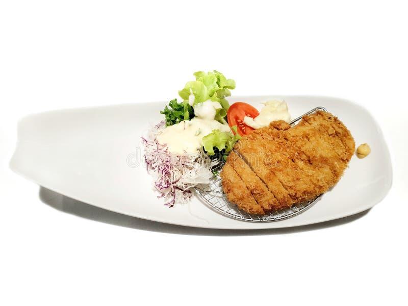 日本食物样式,切的猪肉炸肉排顶视图用菜沙拉 图库摄影