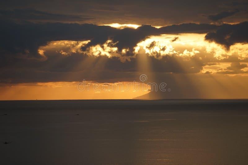 日落、雨和云彩 库存照片