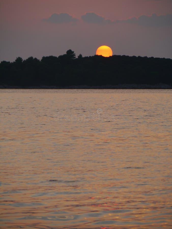 日落在克罗地亚的亚得里亚海 库存照片