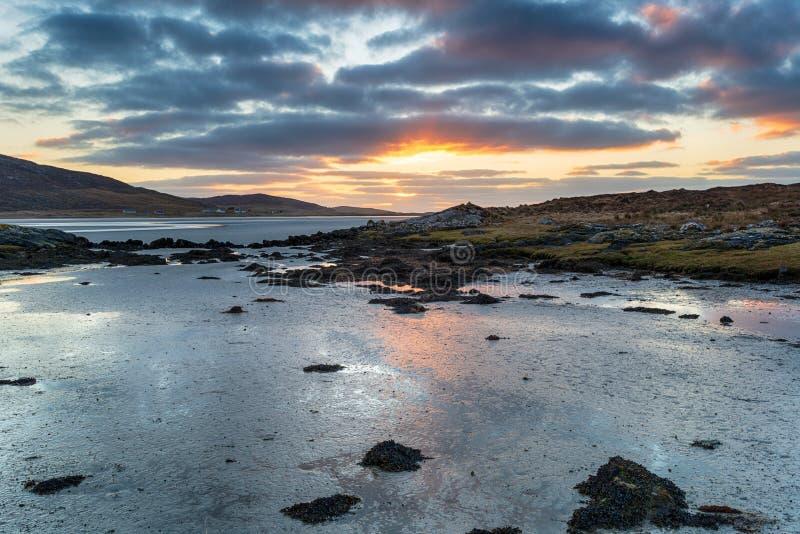 日落在哈里斯岛卢斯肯泰尔海滩 图库摄影