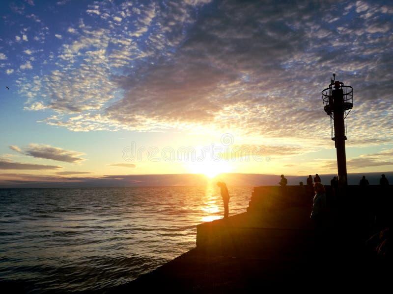 日落在夏天,乌斯特卡,波兰 免版税库存照片