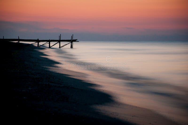 日落在海边 库存图片