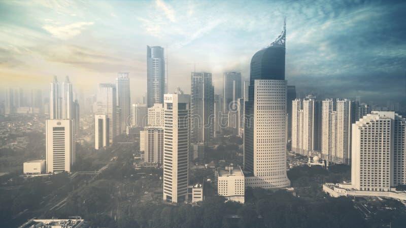 日落时间的摩天大楼在雅加达 库存照片