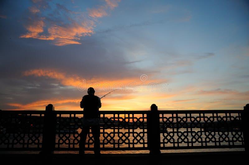 日落的渔夫 免版税库存图片