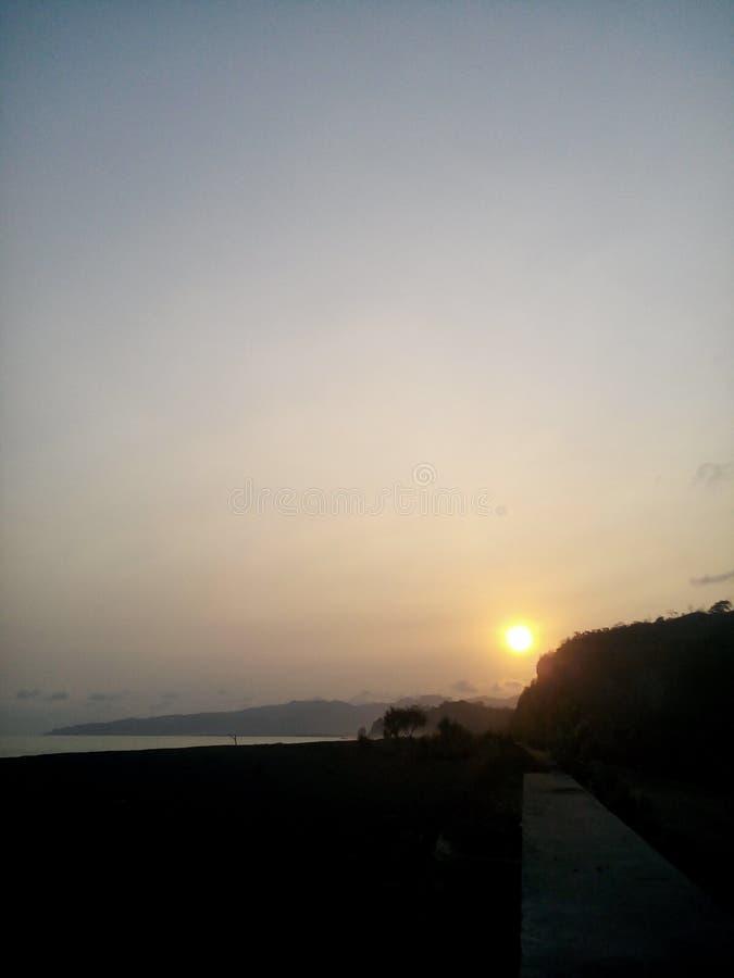 日落Watugedek海滩 库存图片