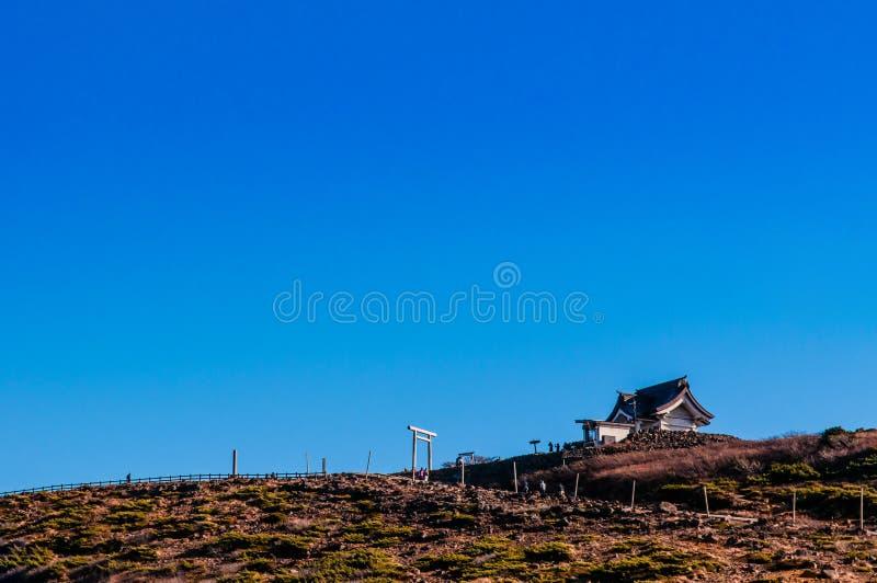 日语祀奉在登上皂市,山形县-宫城,亚帕顶部 免版税库存图片