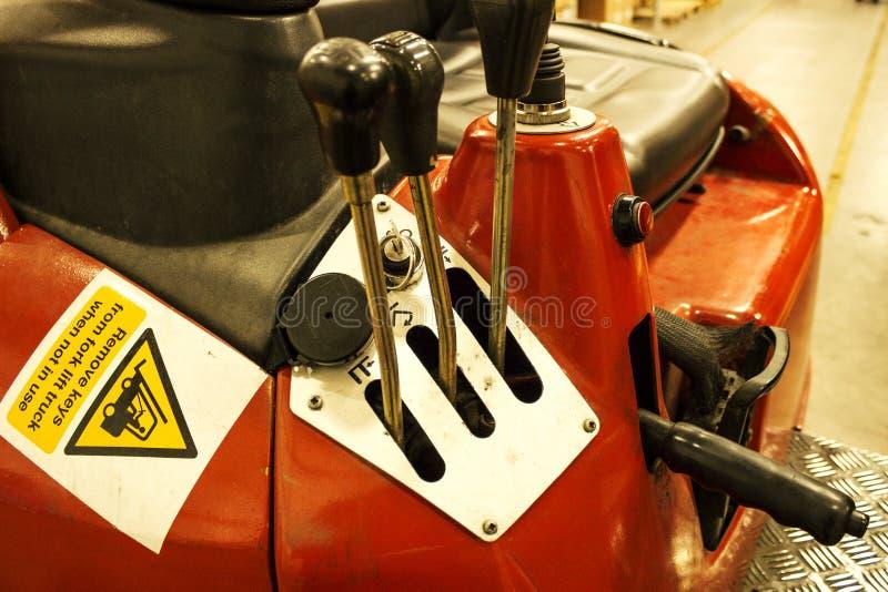破旧的铲车控制 免版税库存图片