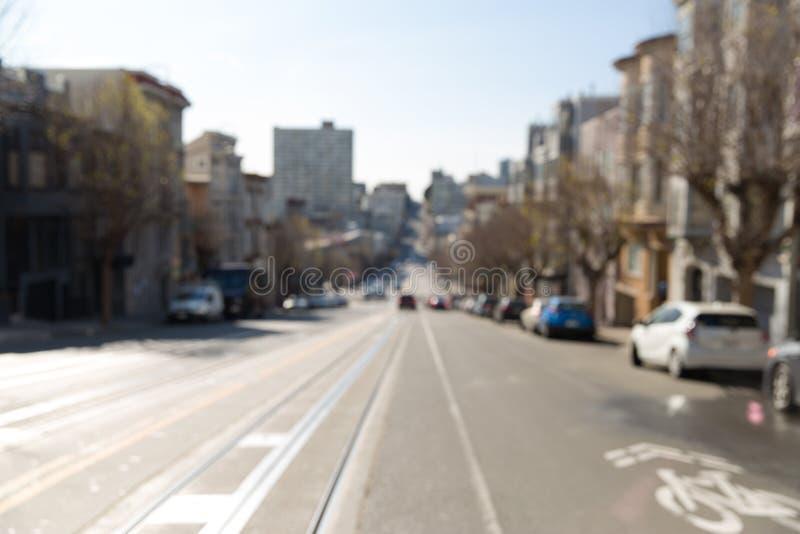 旧金山经营城市街道被弄脏的都市风景  免版税库存照片