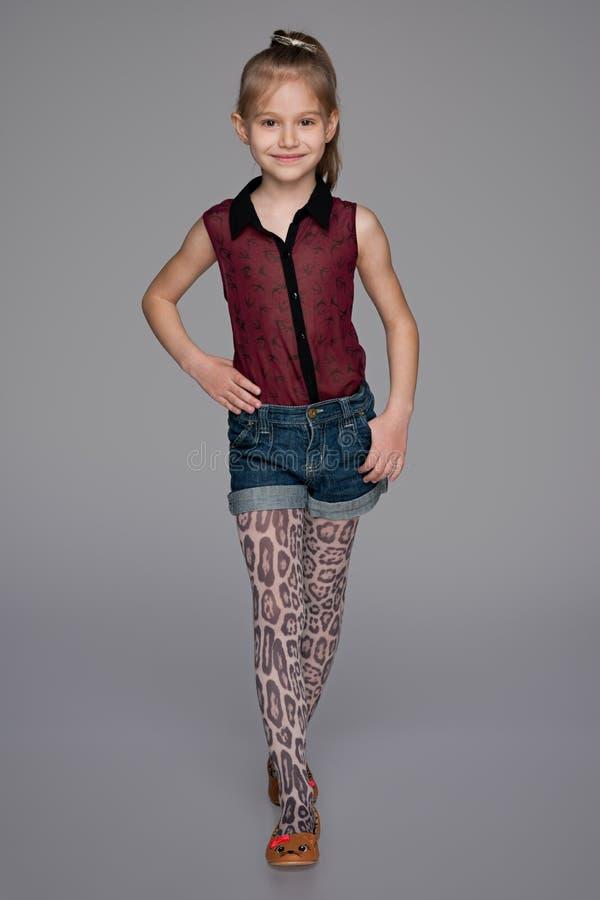 时尚小女孩的画象 免版税库存照片