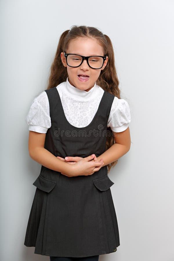 时尚眼睛玻璃的不快乐的学生学校女孩 免版税库存图片