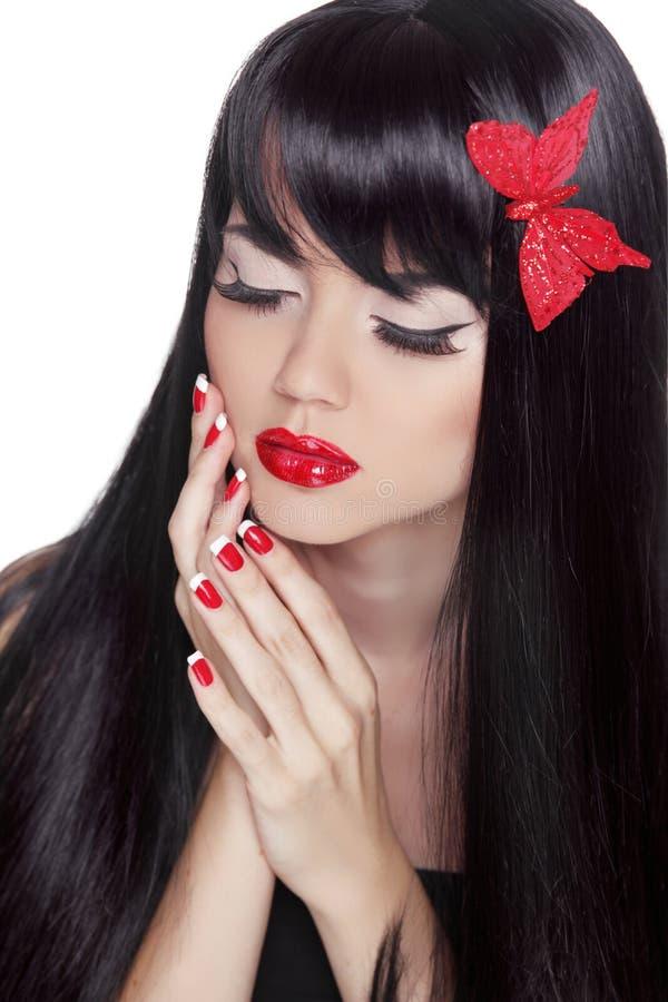 时尚秀丽女孩。华美的妇女画象。长的黑发 免版税库存照片