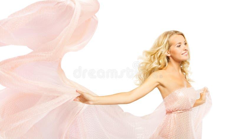 时装模特儿桃红色礼服,挥动的褂子布料的,在白色的秀丽画象妇女 库存照片