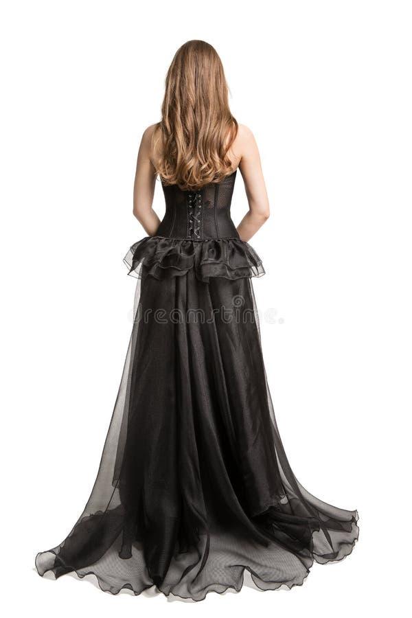 时装模特儿黑礼服,妇女长的褂子后面背面图,看的女孩,白色 免版税库存图片