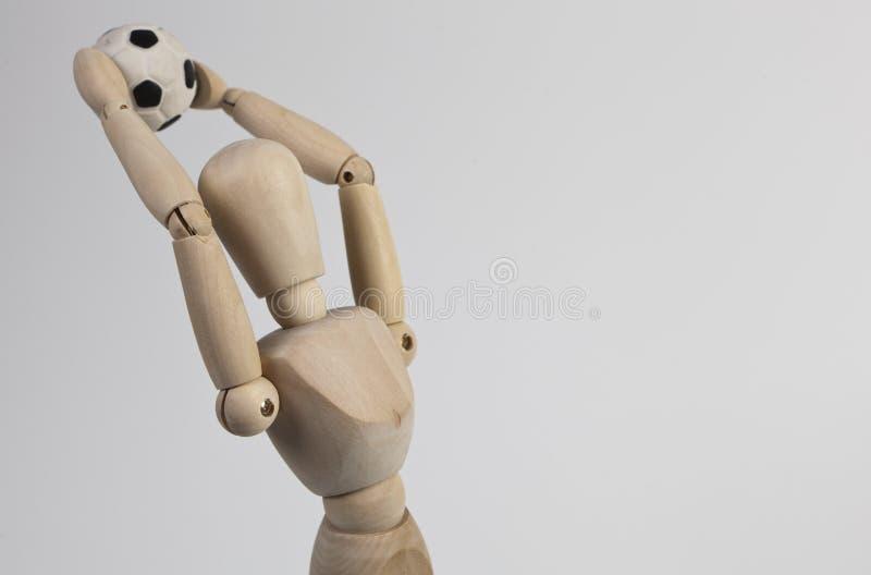 时装模特木作用的足球 免版税库存照片