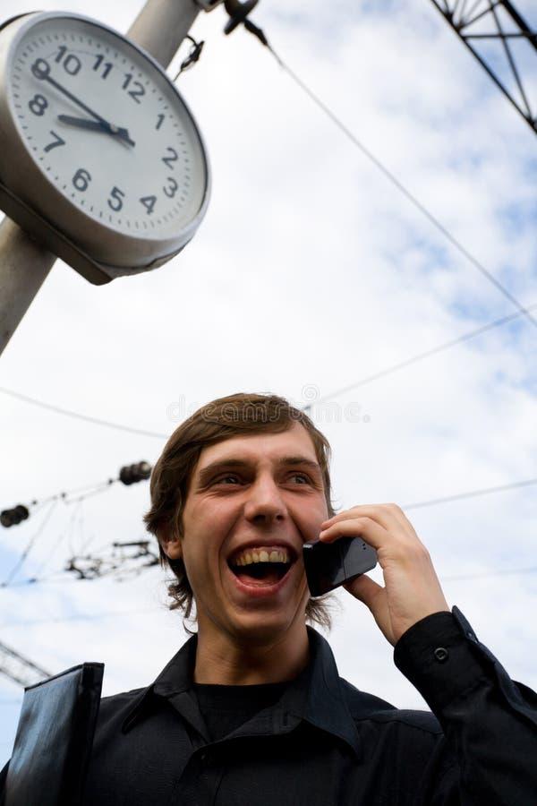 时钟人移动电话 库存图片
