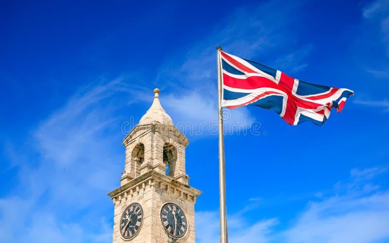 时钟和英国旗子 免版税库存照片