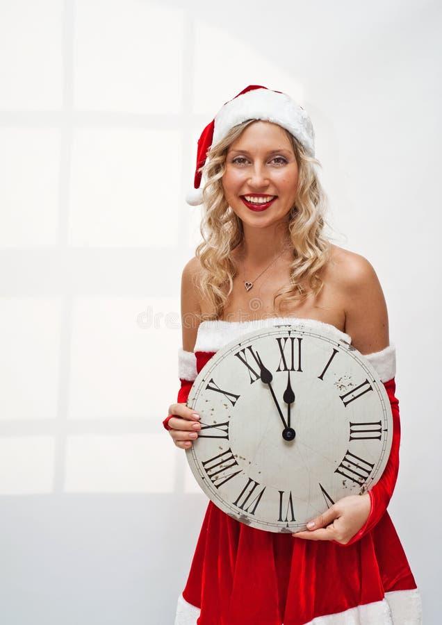 时钟女孩圣诞老人墙壁 库存图片