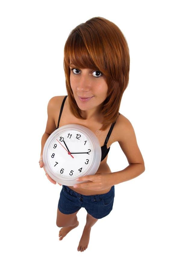 时钟妇女年轻人 免版税库存照片