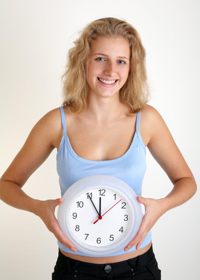 时钟妇女 库存图片