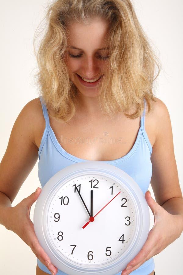时钟妇女 免版税库存图片