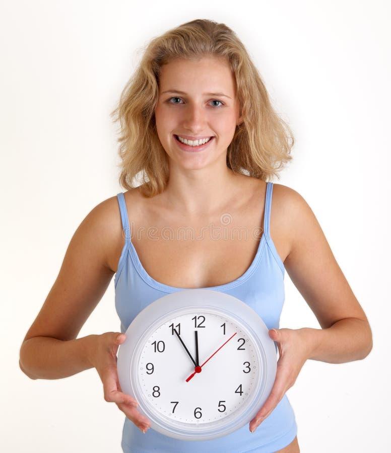 时钟妇女 图库摄影