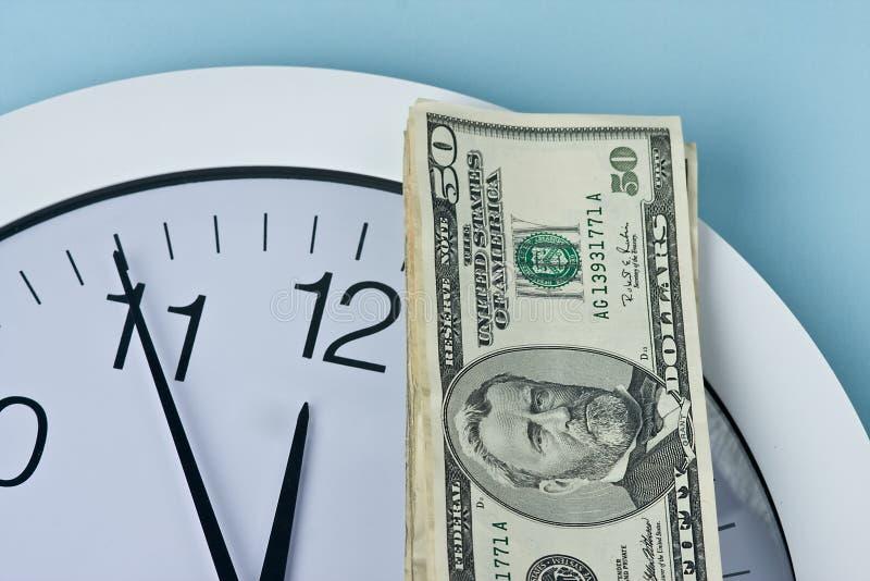 时钟货币 免版税图库摄影