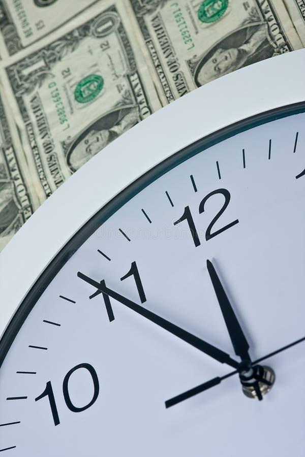 时钟货币 库存照片
