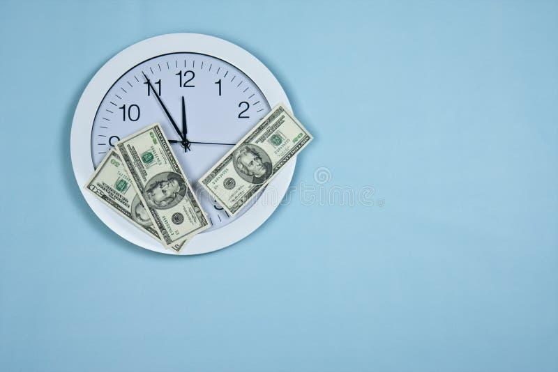 时钟货币 图库摄影