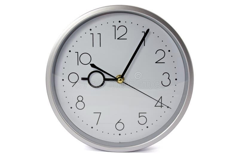 时钟银色墙壁 免版税库存照片