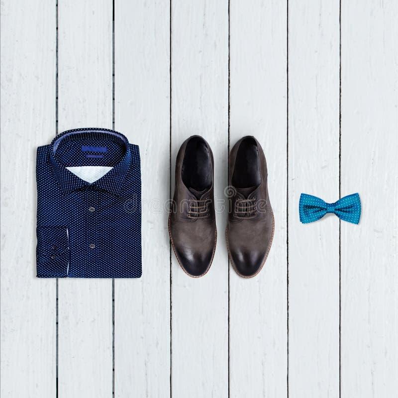 时髦人士的衣物拼贴画在白色背景的 库存照片