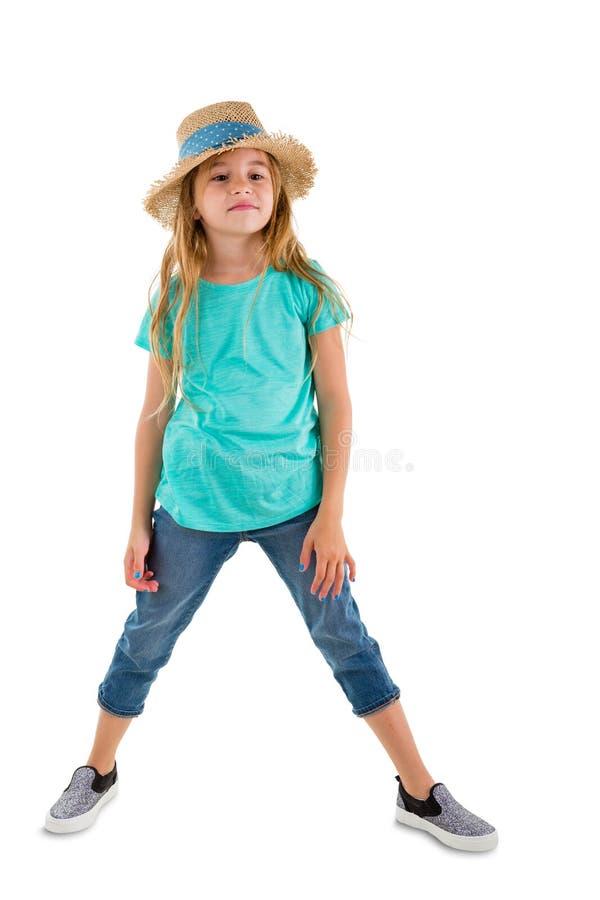 时髦成套装备的确信的矮小的六岁的女孩 免版税库存图片