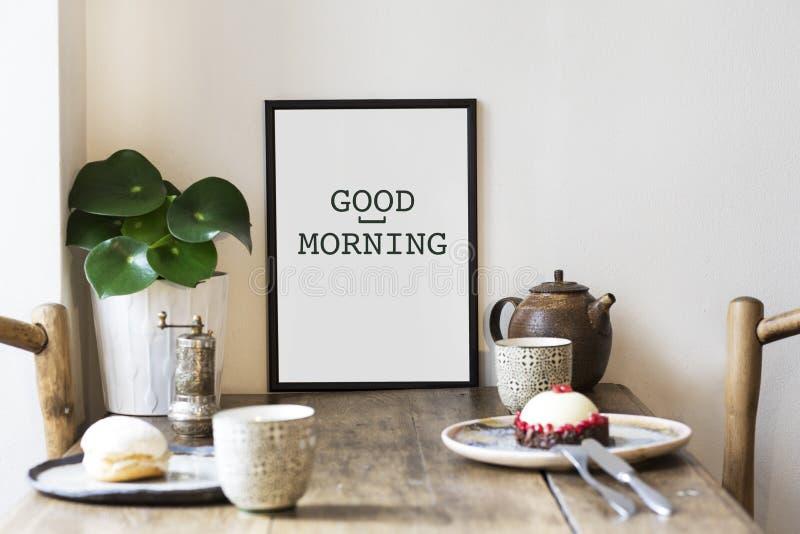 时髦的厨房空间scandi室内设计与小桌的与框架、植物、茶和鲜美点心的嘲笑 免版税库存图片