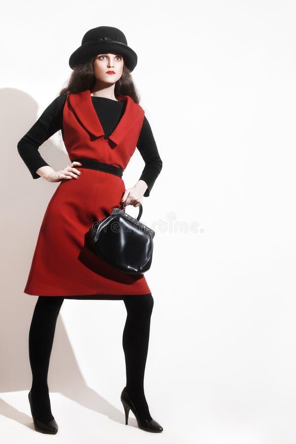 时髦的妇女黑色红色时尚 免版税库存照片
