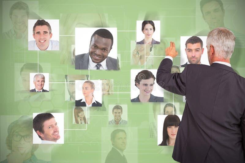 时髦的成熟商人背面图的综合图象指向手指的  免版税图库摄影