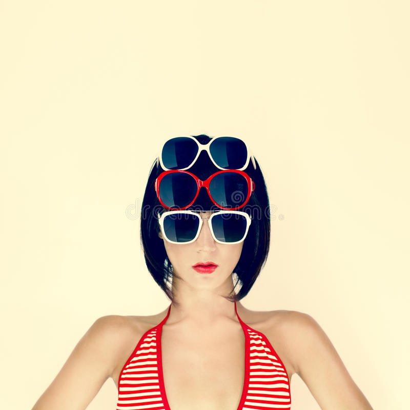 时髦的玻璃的女孩 免版税库存照片