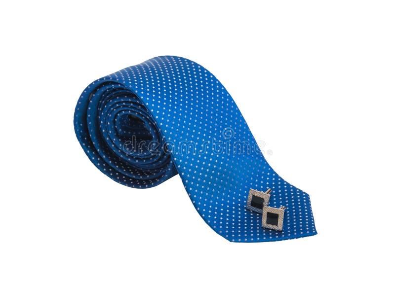 时髦的蓝色滚动的领带和黑在白色隔绝的袖扣 免版税图库摄影