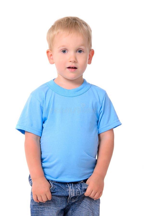 时兴的小男孩画象蓝色衬衣的 库存照片