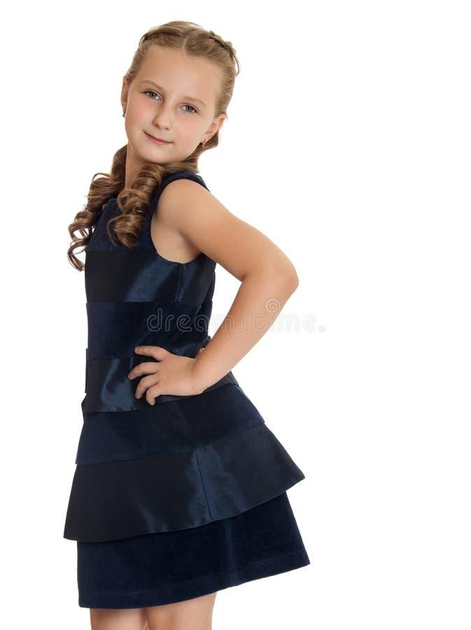 时兴的矮小的女小学生 图库摄影