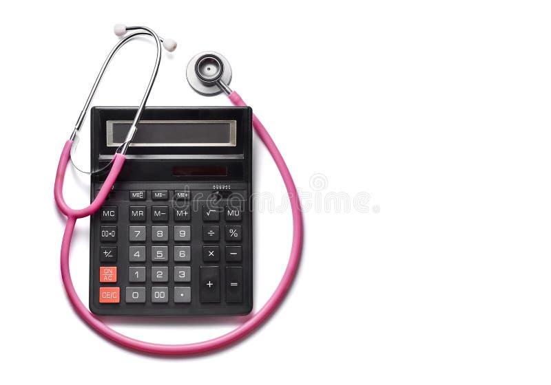 昂贵的医学服务 计算器和听诊器 图库摄影