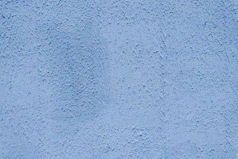 明亮地被绘的表面用发烟性多灰尘的蓝色膏药报道 免版税库存照片